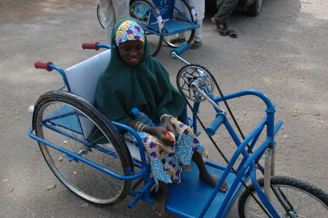polio survivor, Uma, in wheelchair